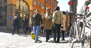 Couple of Tourists Walking in Stockholm. STOCKHOLM, SWEDEN - APRIL 26, 2015: Couple of tourists walking in Stockholm in sunny day. They are holding hands and stock video footage
