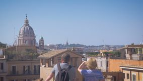 A couple of tourists watching from the height, Rome on a sunny day. 4k stock footage