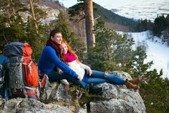 Couple tourists woman and man sitting at the camp in  forest and Royalty Free Stock Photos