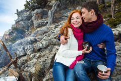 Couple tourists woman and man sitting at the camp in forest and Royalty Free Stock Photo