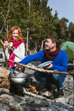 Couple tourists woman and man sitting at the camp in forest and Stock Images