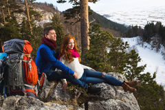 Couple tourists woman and man sitting at the camp in the forest Stock Photography