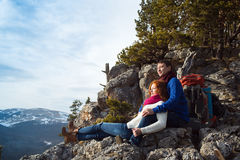 Couple tourists woman and man sitting at the camp in the forest Royalty Free Stock Photo