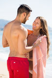 Couple in towel resting on sea beach Royalty Free Stock Photo
