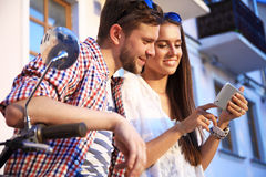 Couple in town using smartphone Stock Photos