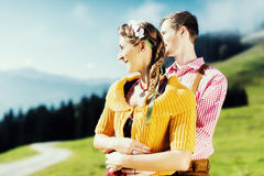 Couple in Tracht on Alp mountain summit Stock Photography