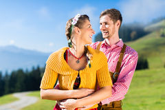 Couple in Tracht on Alp mountain summit at vacation Royalty Free Stock Images