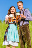 Couple in Tracht with beer and pretzel Royalty Free Stock Image