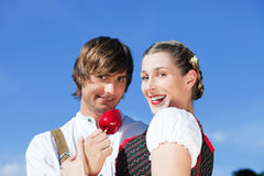 Couple in Tracht on Dult or Oktoberfest Stock Photo