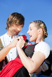 Couple in Tracht on Dult or Oktoberfest Royalty Free Stock Photo
