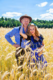 Couple in Tracht on the field Stock Images