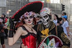 Couple in tradicional skull costume in Zombie Walk Sao Paulo Stock Images