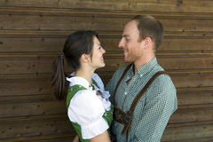 Couple in traditional bavarian clothes hugging each other Stock Photography