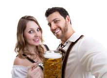 Couple in traditional bavarian costume on white background Stock Photos