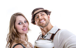 Couple in traditional bavarian costume on white background Royalty Free Stock Photography