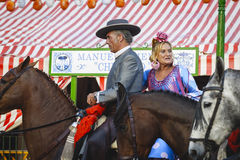 Couple in traditional dress riding at the April Fair Seville Royalty Free Stock Photos