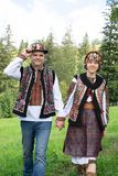 Couple in traditional ukrainian clothes in the Carpathians. Young couple in traditional ukrainian clothes in the Carpathian mountains near the house full of love stock images