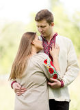 Couple in traditional ukrainian clothes hugging at meadow Stock Image