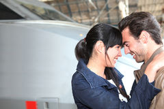 Couple at the train station. Couple smiling at the train station Royalty Free Stock Image