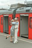 Couple at train station Stock Photography