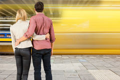Couple at a train station Stock Photos