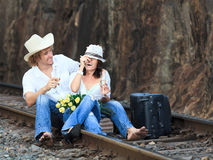Couple on train tracks Royalty Free Stock Photo