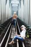 Couple on train tracks stock photography