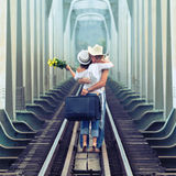 Couple on train tracks. Young couple hugging on a train tracks royalty free stock photos