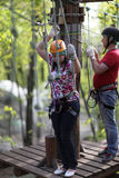 Couple training in adventure park Stock Photo