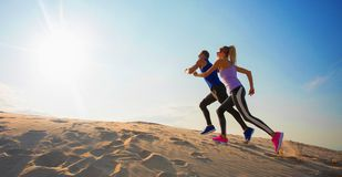 Woman and man training hard together stock photo