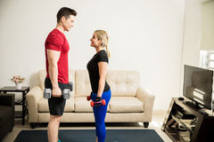Couple training and lifting weights together Royalty Free Stock Photo