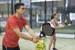 Couple training paddle tennis Royalty Free Stock Image