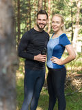 Couple training stretching after workout in nature Stock Photos