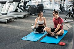 Couple Training Together in Gym stock photos