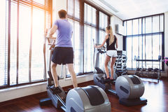 Couple training on a treadmill in a sport center Royalty Free Stock Image