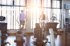 Couple training on a treadmill in a sport centre Stock Photos