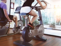 Couple training on a treadmill in a sport centre Stock Photo