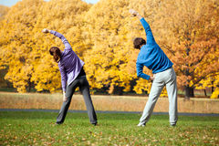 Couple traininig in the park. Young couple training in the park in sunny day Stock Photo