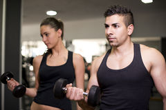 Couple traning at gym Royalty Free Stock Photos