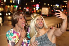 Couple of transvestites taking a selfie outdoors stock images