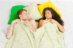 Couple trapped at the bedroom Stock Photos