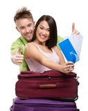 Couple with travel bags and tickets Royalty Free Stock Images