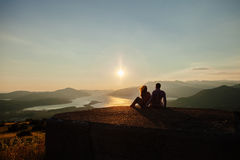 Couple travel mountains at sunset. Picturesque landscape. Travelling Europe at honeymoon. Mountains and sea view at sunset Royalty Free Stock Photos
