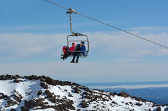 Couple travel on Ski lift to top of Mount Ruapehu Stock Images