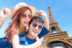 Couple travel to paris. And smile happily stock photography
