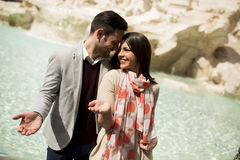 Couple on travel by Trevi Fountain in Rome, Italy. Stock Images
