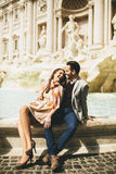 Couple on travel by Trevi Fountain in Rome, Italy. Stock Photo