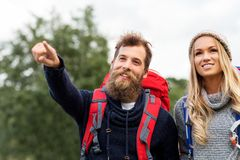 Couple of travelers with backpacks hiking royalty free stock images
