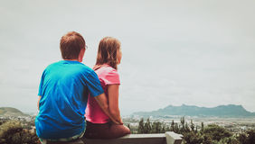 Couple of travelers enjoying nature, city and sky Stock Images