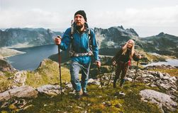 Couple travelers hiking in mountains family traveling. Together adventure lifestyle concept vacations outdoor stock image